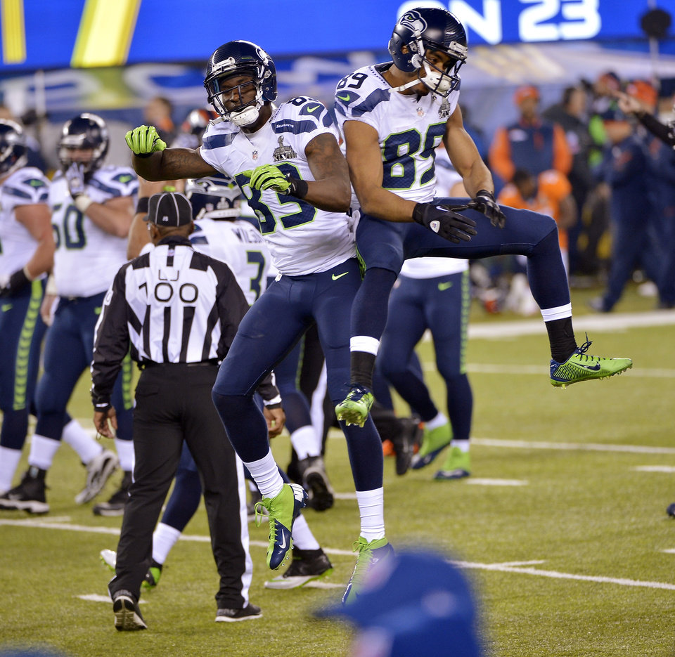 Photo - Seattle Seahawks' Ricardo Lockette (83) and Doug Baldwin celebrate during the second half of the NFL Super Bowl XLVIII football game against the Denver Broncos Sunday, Feb. 2, 2014, in East Rutherford, N.J. (AP Photo/Bill Kostroun)
