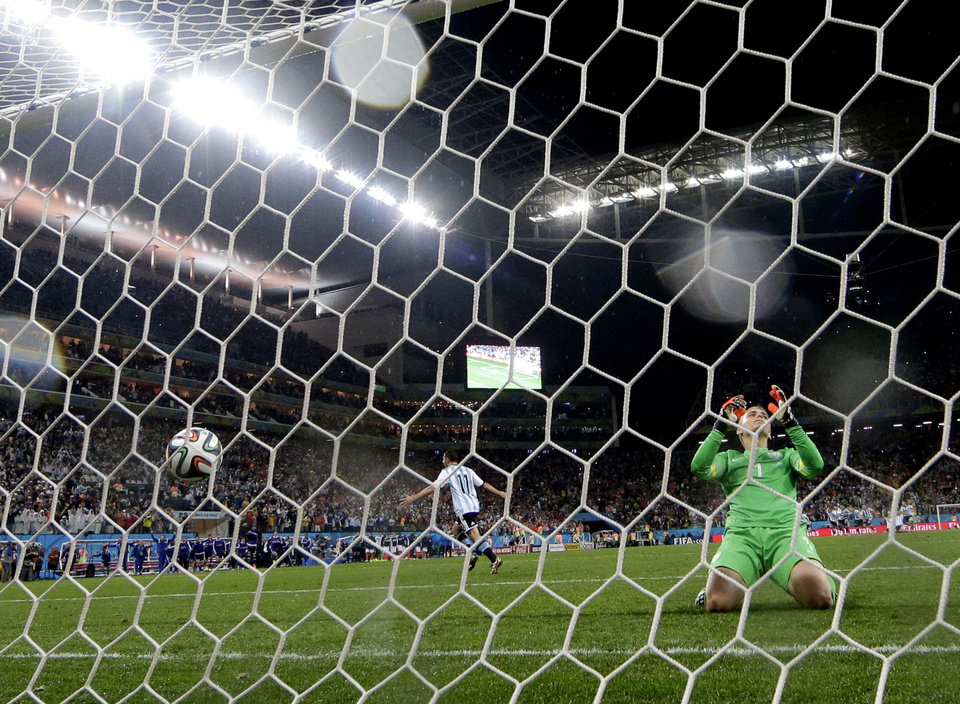Photo - Netherlands' goalkeeper Jasper Cillessen reacts after Argentina's Maxi Rodriguez scored the winning goal during a penalty shootout after extra time during the World Cup semifinal soccer match between the Netherlands and Argentina at the Itaquerao Stadium in Sao Paulo Brazil, Wednesday, July 9, 2014. Argentina defeated the Netherlands 4-2 in a penalty shootout after a 0-0 tie to advance to the finals. (AP Photo/Victor R. Caivano)