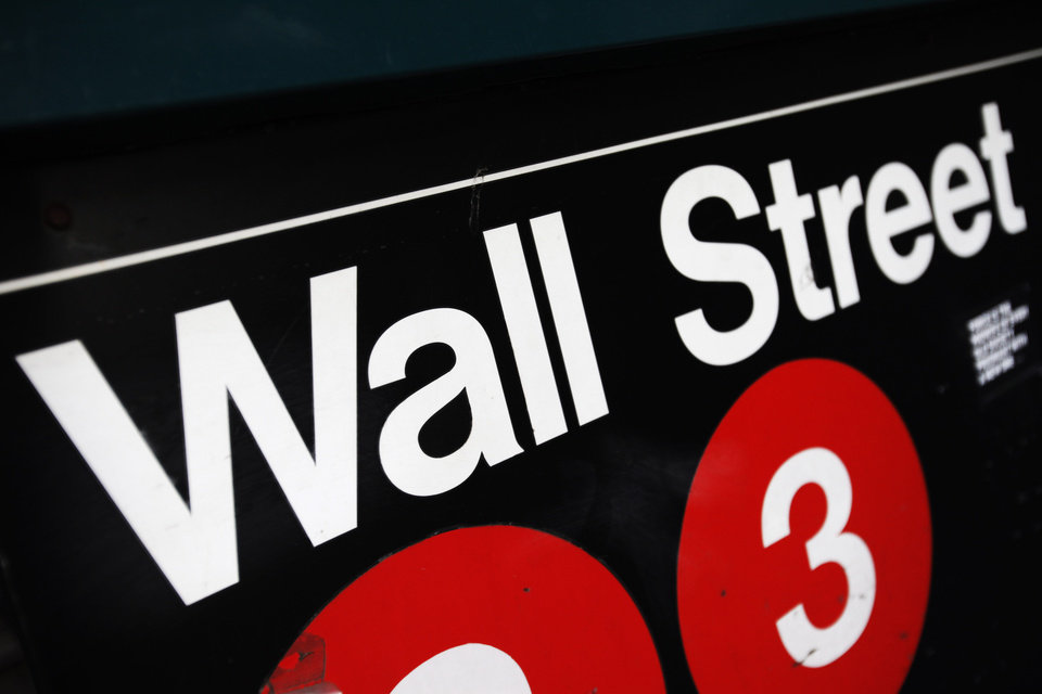 FILE - This Jan. 4, 2010 file photo shows an entrance to a Wall Street subway station in New York. U.S. stocks are opening higher Monday, Aug. 11, 2014, as tensions ease in Ukraine.  (AP Photo/Mark Lennihan, File)