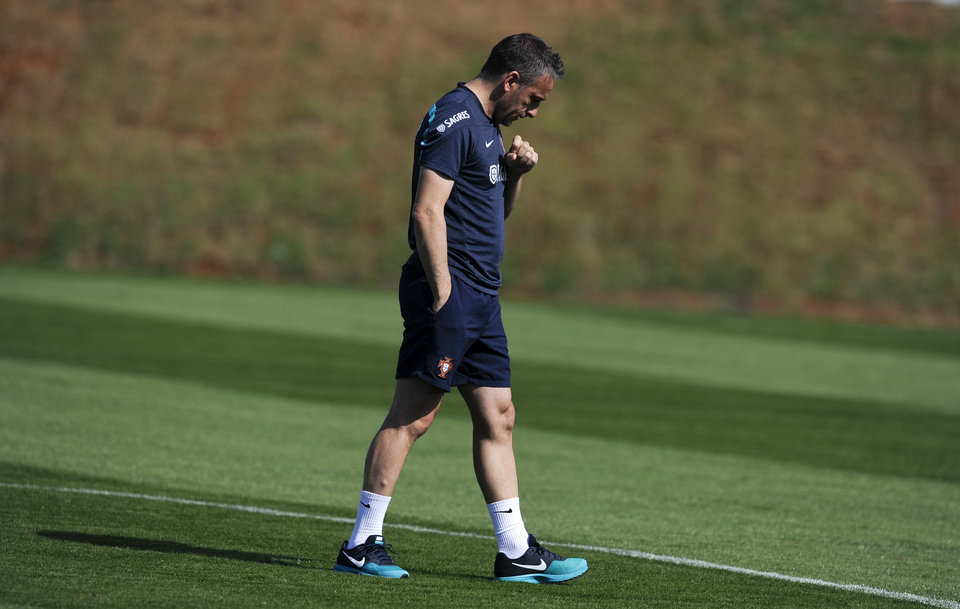 Photo - Portugal's head coach Paulo Bento walks on the pitch during a training session in Campinas, Brazil, Tuesday, June 24, 2014. Portugal plays in group G of the Brazil 2014 soccer World Cup. (AP Photo/Paulo Duarte)