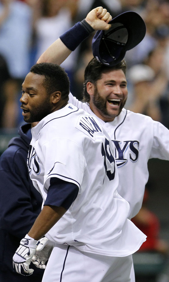 Photo -   Tampa Bay Rays' Brandon Allen, left, celebrates with teammate Luke Scott after Allen hit the game-winning, two-run walk off home run off Los Angeles Angels relief pitcher Jordan Walden during the ninth inning of a baseball game, Thursday, April 26, 2012, in St. Petersburg, Fla. The Rays won 4-3. (AP Photo/Chris O'Meara)