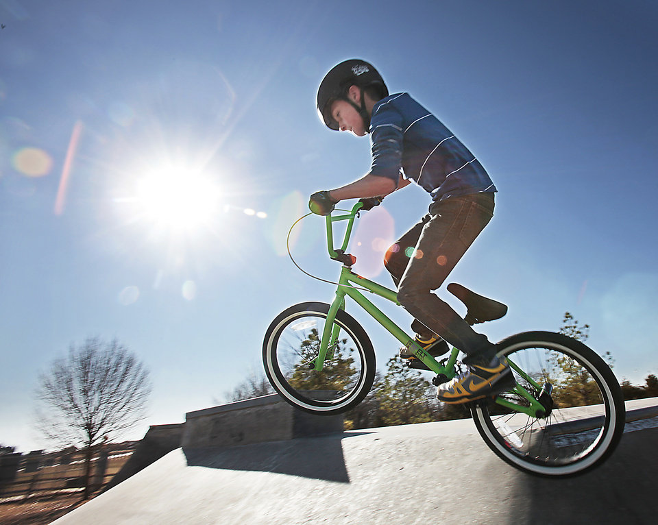 Blake Bella, 10, rides his bicycle he got for Christmas at Mitch Park in Edmond, Wednesday, December 28, 2011.     Photo by David McDaniel, The Oklahoman  ORG XMIT: KOD