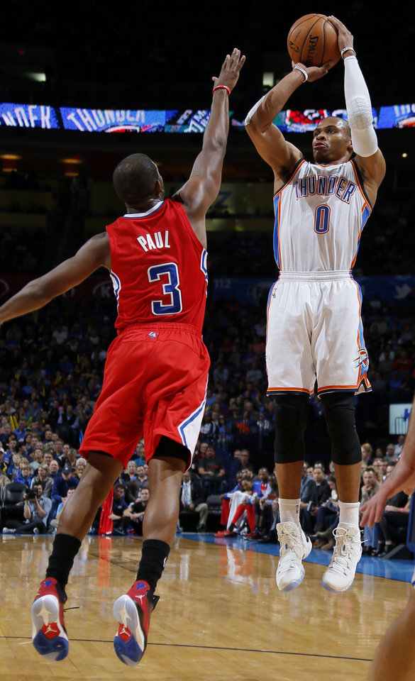 Oklahoma City's Russell Westbrook shoots over Chris Paul of the Clippers during an NBA basketball game between the Oklahoma City Thunder and the Los Angeles Clippers at Chesapeake Energey Arena in Oklahoma City, Sunday, Nov. 3, 2013. Photo by Bryan Terry, The Oklahoman