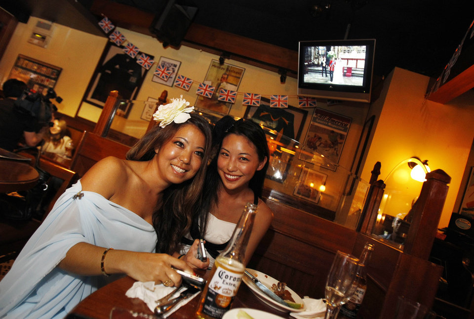 Photo - Locals dressed up for the occasion watch the Royal Wedding of Prince William and Kate Middleton in a local pub in Taipei, Taiwan, April 29, 2011. (AP Photo/Wally Santana) ORG XMIT: TPE101
