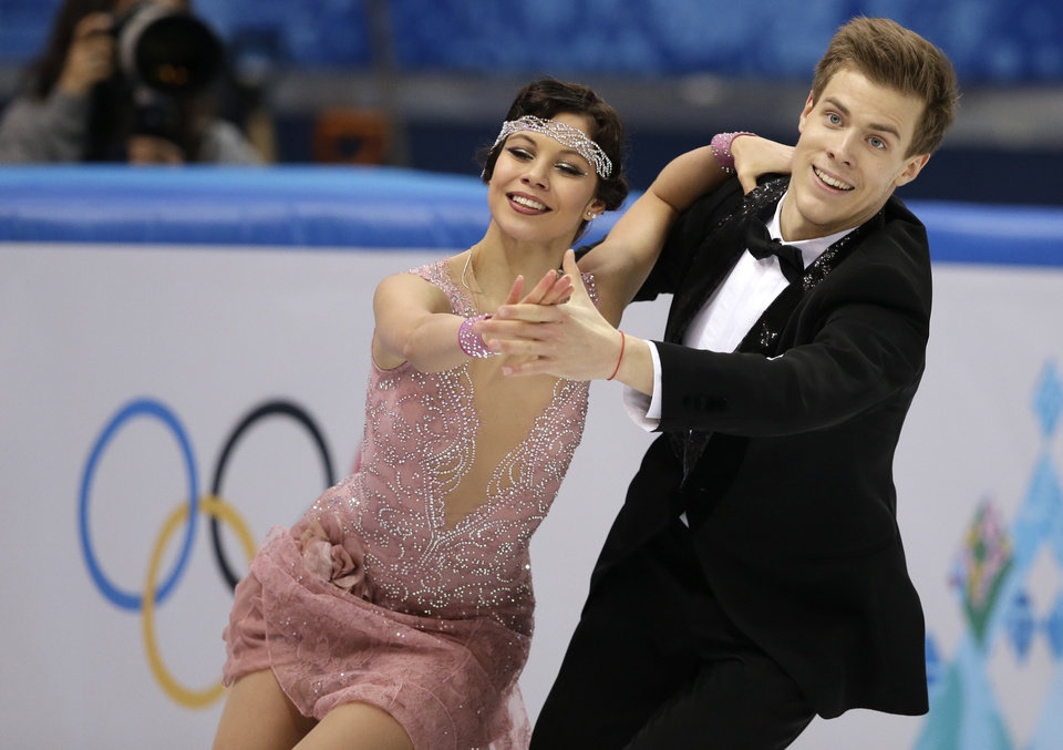 Photo - Elena Ilinykh and Nikita Katsalapov of Russia compete in the ice dance short dance figure skating competition at the Iceberg Skating Palace during the 2014 Winter Olympics, Sunday, Feb. 16, 2014, in Sochi, Russia. (AP Photo/Darron Cummings)
