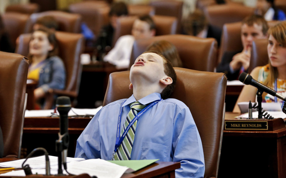 Seth Hagler reacts to a comment as a bill is debated in the house while about 100 seventh and eight grade students from across the state assume roles of state legislators at the State Capitol on Friday, March 29, 2013, in Oklahoma City, Okla.  Photo by Chris Landsberger, The Oklahoman