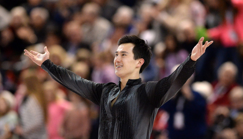Photo - Patrick Chan competes during the men's short program at the Canadian Figure Skating Championships, Friday, Jan. 10, 2014, in Ottawa, Ontario. Chan was in first place following the program. (AP Photo/The Canadian Press, Sean Kilpatrick)