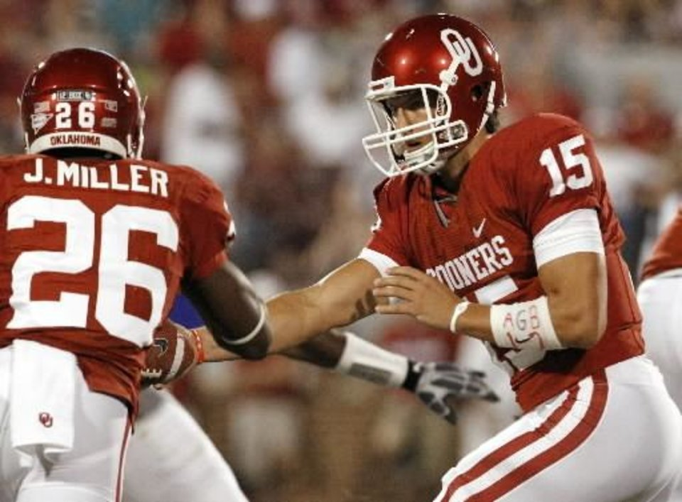 Oklahoma's Drew Allen (15) hands off to Jonathan Miller (26) during the second half of the college football game between the University of Oklahoma Sooners ( OU) and the Tulsa University Hurricanes (TU) at the Gaylord Family-Memorial Stadium on Saturday, Sept. 3, 2011, in Norman, Okla. Photo by Steve Sisney, The Oklahoman ORG XMIT: KOD