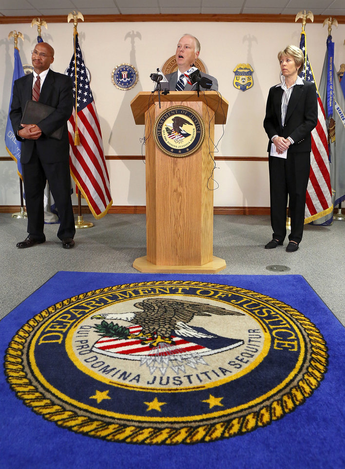 Photo - Federal officials announced at a news conference Monday, Sept. 24, 2012,  the unsealing of an 81-count federal indictment charging 10 defendants with crimes involving an illegal gambling operation and the money of proceeds derived from that operation. Making the announcement are  Sanford C. Coats, at microphone, and Jim Finch, left.   Joining the announcement team is Andrea Whelan, right. Finch is special agent in charge  of the FBI. Coats is U.S. attorney for the Western District of Oklahoma. Whelan is special agent in charge of IRS Criminal Investigation.   Photo by Jim Beckel, The Oklahoman.  Jim Beckel - THE OKLAHOMAN