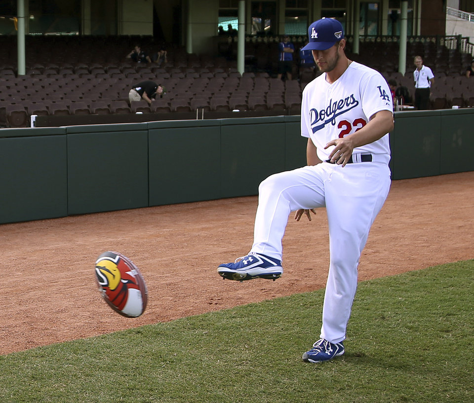Photo - The Los Angeles Dodgers' Clayton Kershaw kicks a rugby league ball at the Sydney Cricket Ground in Sydney, Wednesday, March 19, 2014. The MLB season-opening two-game series between the Dodgers and Diamondbacks in Sydney will be played this weekend. (AP Photo/Rick Rycroft)