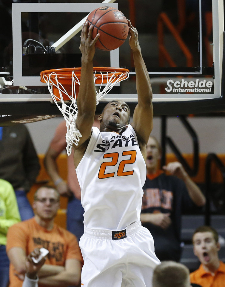Photo - Oklahoma State's Markel Brown dunks against Utah Valley in the first half of an NCAA college basketball game in Stillwater, Okla., Tuesday, Nov. 12, 2013. (AP Photo/Sue Ogrocki)