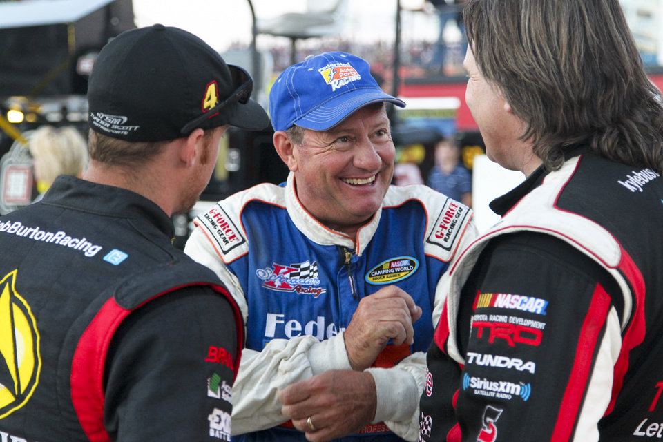 Photo - Ken Schrader talks with fellow racers after winning his qualifying race and setting the fastest time in qualifying for the NASCAR Truck Series auto race Wednesday, July 24, 2013, on the dirt at Eldora Speedway in Rossburg, Ohio. (AP Photo/Dayton Daily News, Greg Lynch) LOCAL PRINT OUT AND LOCAL TV OUT (WKEF, WRGT, WDTN)