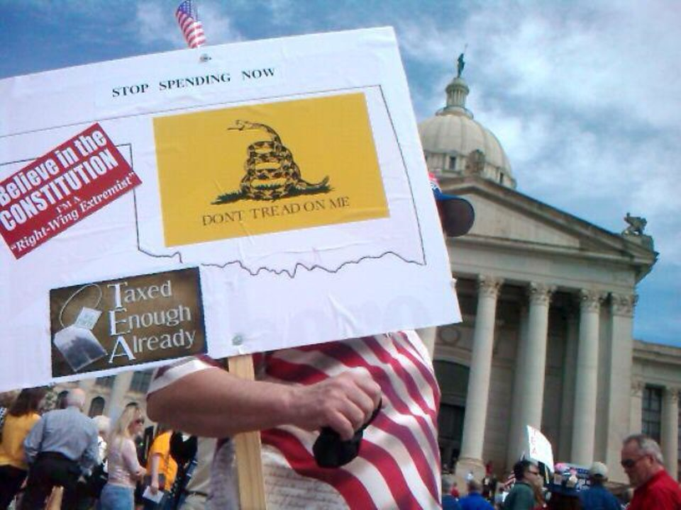 Photo - A protester holds a sign at the Oklahoma Capitol on Wednesday. Chris Landsberger