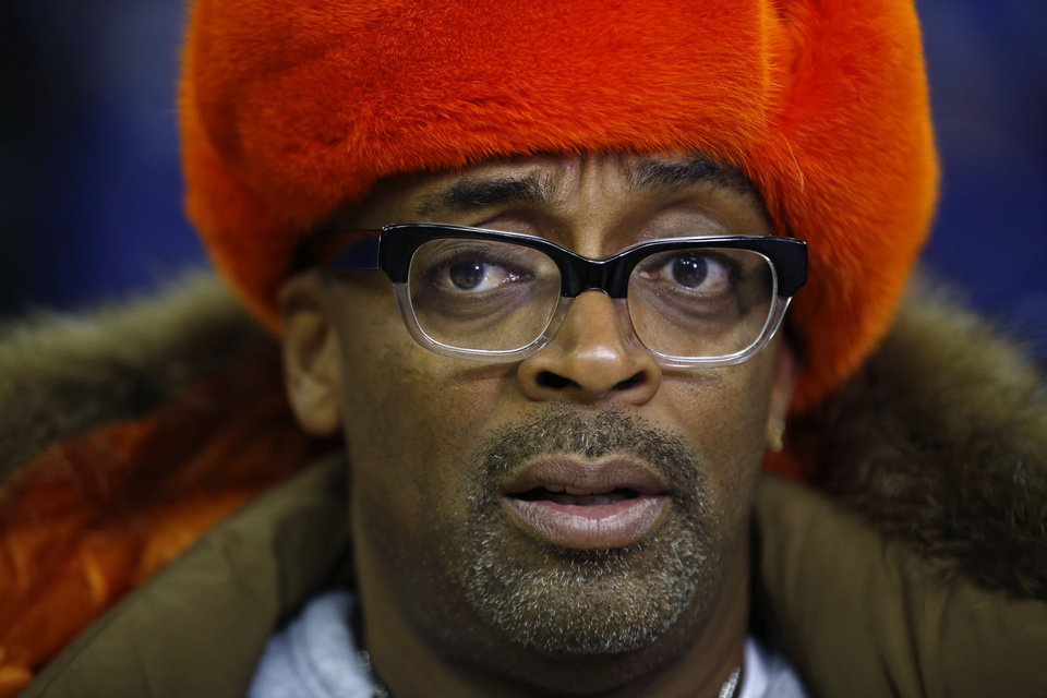 Photo - U.S. movie director Spike Lee speaks as he is interviewed by members of the media before a New York Knicks training session at the 02 arena in London, Wednesday, Jan. 16, 2013.  The Detroit Pistons are due to play a