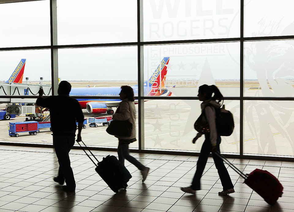 Holiday travelers head for their flights at Will Rogers World Airport. Photo by David McDaniel, The Oklahoman Archives
