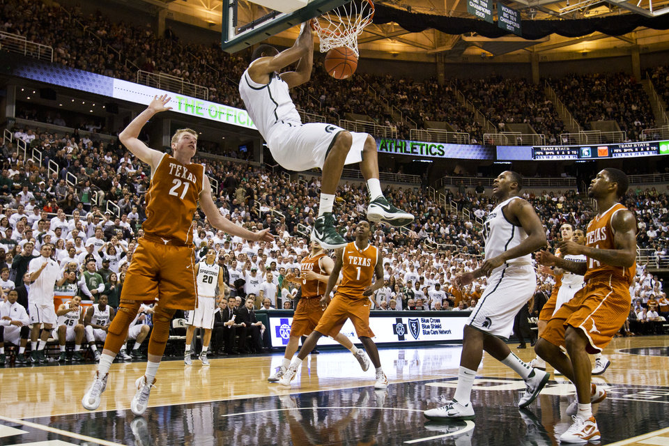 Michigan State's Keith Appling (5) dunks against Texas during an NCAA college basketball game Saturday, Dec. 22, 2012, in East Lansing, Mich. (AP Photo/Jackson Citizen Patriot, Mike Mulholland) LOCAL TV OUT  LOCAL INTERNET OUT