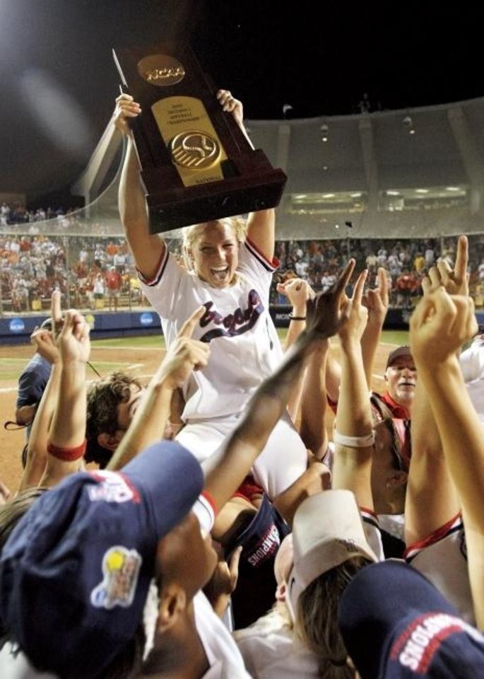 Photo -  Arizona pitcher Taryne Mowatt (9) raises the national championship trophy as she is held by her teammates after Arizona beat Tennessee to win the Women's College World Series Championship  in 2007. [NATE BILLINGS/THE OKLAHOMAN]