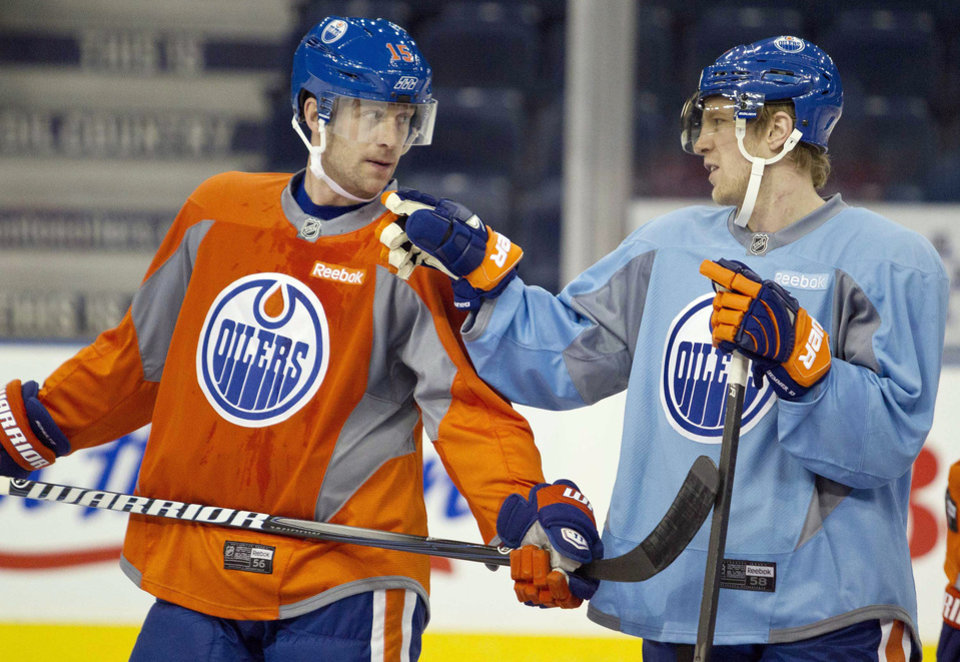 Photo - Edmonton Oilers' Nick Schultz, left, and Ales Hemsky discuss a drill during their NHL hockey training camp in Edmonton, Alberta, Monday, Jan. 14, 2013. (AP Photo/The Canadian Press, Jason Franson)