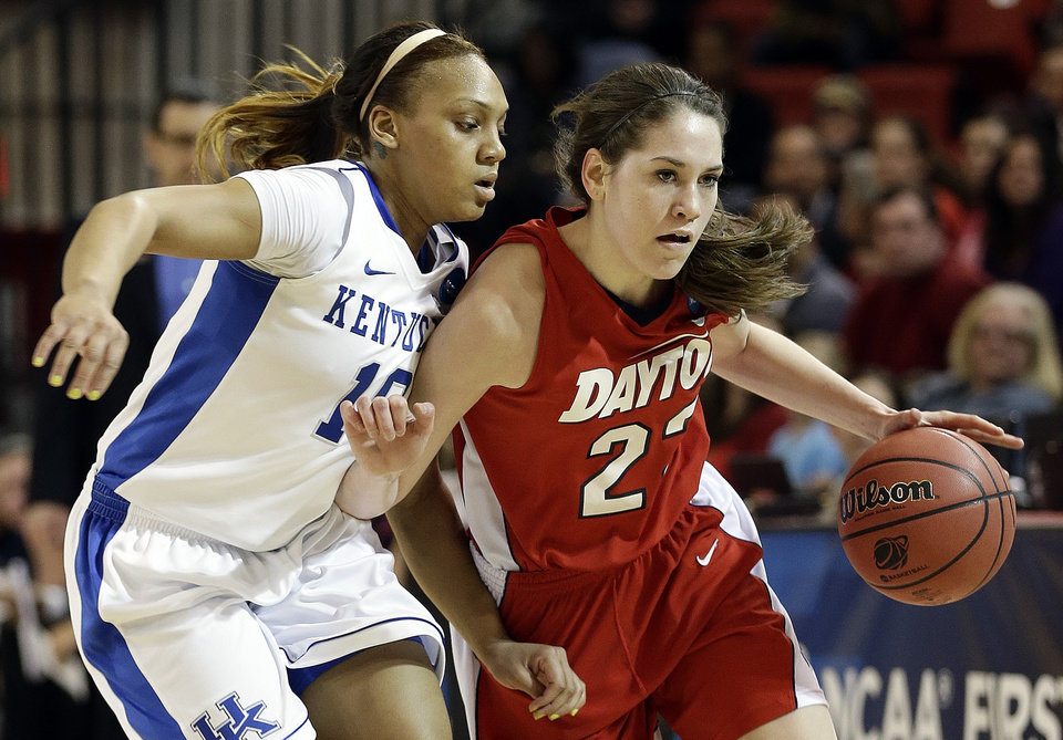 Kentucky's Bernisha Pinkett (10) defends Dayton's Kelley Austria (22) in the first half of a second-round game in the NCAA women's college basketball tournament Tuesday, March 26, 2013, in New York. (AP Photo/Frank Franklin)