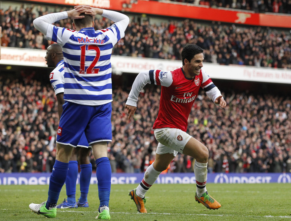 Photo -   Arsenal's Mikel Arteta, right, celebrates his goal against Queens Park Rangers during their English Premier League soccer match at Emirates stadium, London, Saturday, Oct. 27, 2012. (AP Photo/Sang Tan)