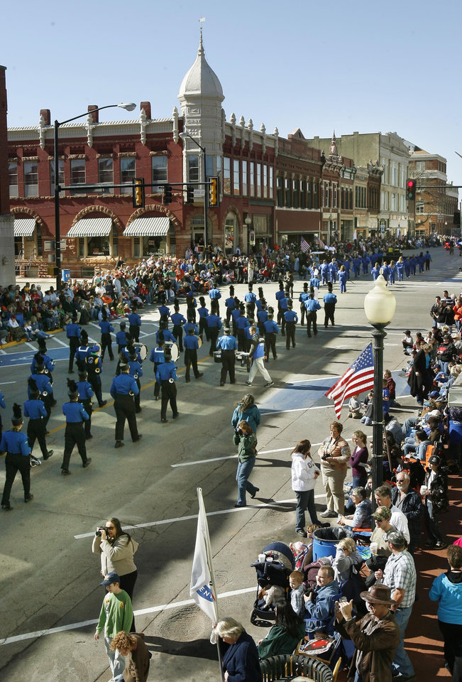 Photo - The Guthrie High School Band, part of the Oklahoma Centennial Day Parade, moves down Oklahoma Avenue, during the Centennial Day celebrations in downtown Guthrie, OK, Thursday, Nov. 16, 2007. By Paul Hellstern / The Oklahoman