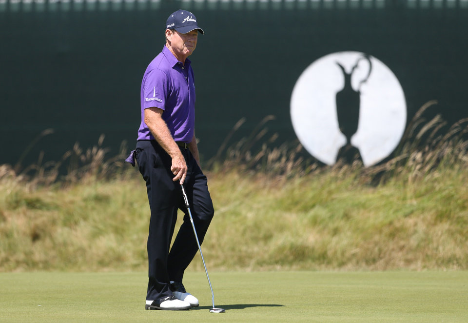 Photo - Tom Watson of the US prepares to putt on the 15th green during a practice round ahead of the British Open Golf championship at the Royal Liverpool golf club, Hoylake, England, Tuesday July 15, 2014. The British Open Golf championship starts Thursday July 17. (AP Photo/Peter Morrison)