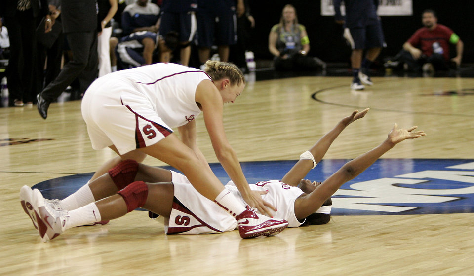 Photo - Stanford University's Jayne Appel, left, runs out to teammate Nnemkadi Ogwumike after Stanford beat Xavier 55-53 on a shot at the buzzer  in the final of the NCAA women's college basketball tournament Sacramento Regional in Sacramento, Calif., Monday, March 29, 2010. (AP Photo/Rich Pedroncelli) ORG XMIT: SCA117