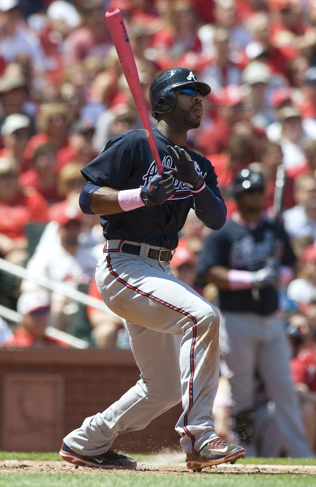 Atlanta Braves' Jason Heyward watches his three-run double during the third inning of a baseball game against the St. Louis Cardinals on Sunday, May 13, 2012, in St. Louis. (AP Photo/Jeff Curry)