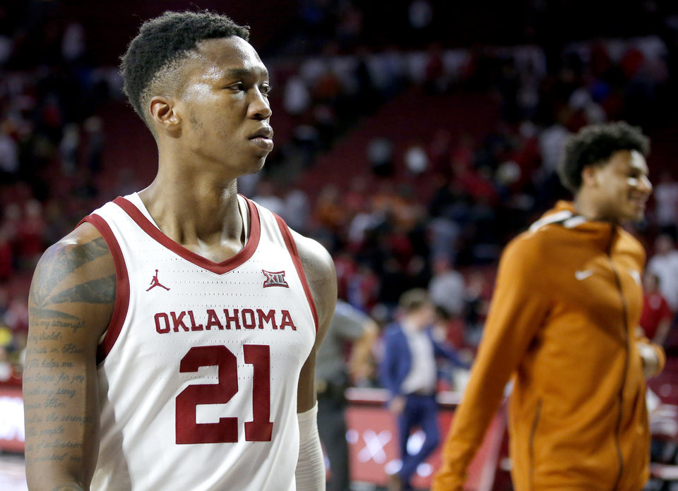Photo - Oklahoma's Kristian Doolittle (21) walks off the court following the men's basketball game between Oklahoma and Texas at Lloyd Noble Center in Norman, Okla., Tuesday, March 3, 2020. OU lost 52-51. [Sarah Phipps/The Oklahoman]