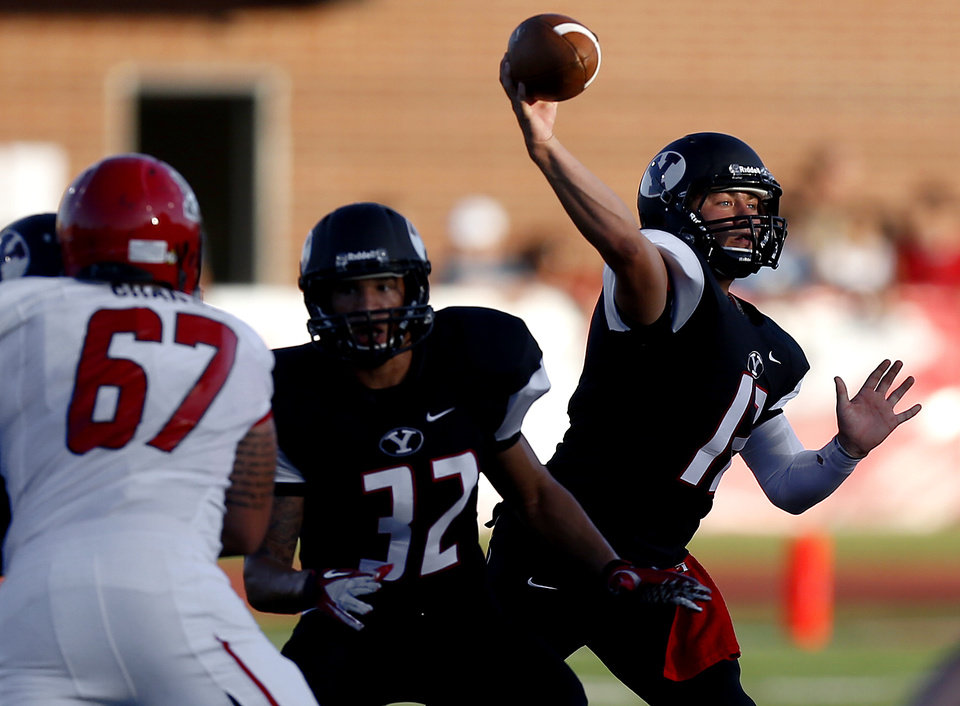 Photo - Yukon's Hayden Somerville throws a pass during a high school football game between Yukon and Mustang in Yukon, Okla., Friday, August 31, 2012. Photo by Bryan Terry, The Oklahoman