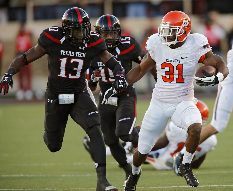 Oklahoma State 's Jeremy Smith (31) runs past Texas Tech's Sam Eguavoen (13) during the college football game between the Oklahoma State University Cowboys (OSU) and the Texas Tech University Red Raiders (TTU) at Jones AT&T Stadium in Lubbock, Tex. on Saturday, Nov. 2, 2013.  Photo by Chris Landsberger, The Oklahoman
