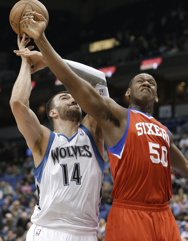 Philadelphia 76ers' Lavoy Allen, right, breaks up a scoring attempt by Minnesota Timberwolves' Nikola Pekovic, of Montenegro, in the first quarter of an NBA basketball game Wednesday, Feb. 20, 2013, in Minneapolis. (AP Photo/Jim Mone)