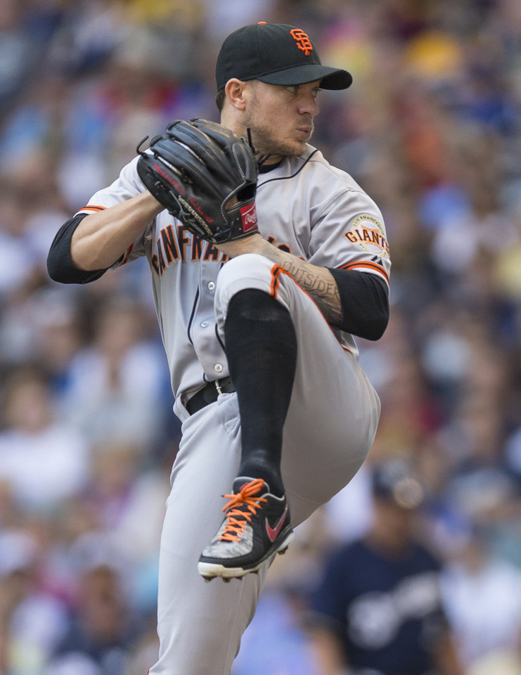 Photo - San Francisco Giants'  Jake Peavy pitches to a Milwaukee Brewers' batter during the first inning of a baseball game Thursday, Aug. 7, 2014, in Milwaukee. (AP Photo/Tom Lynn)