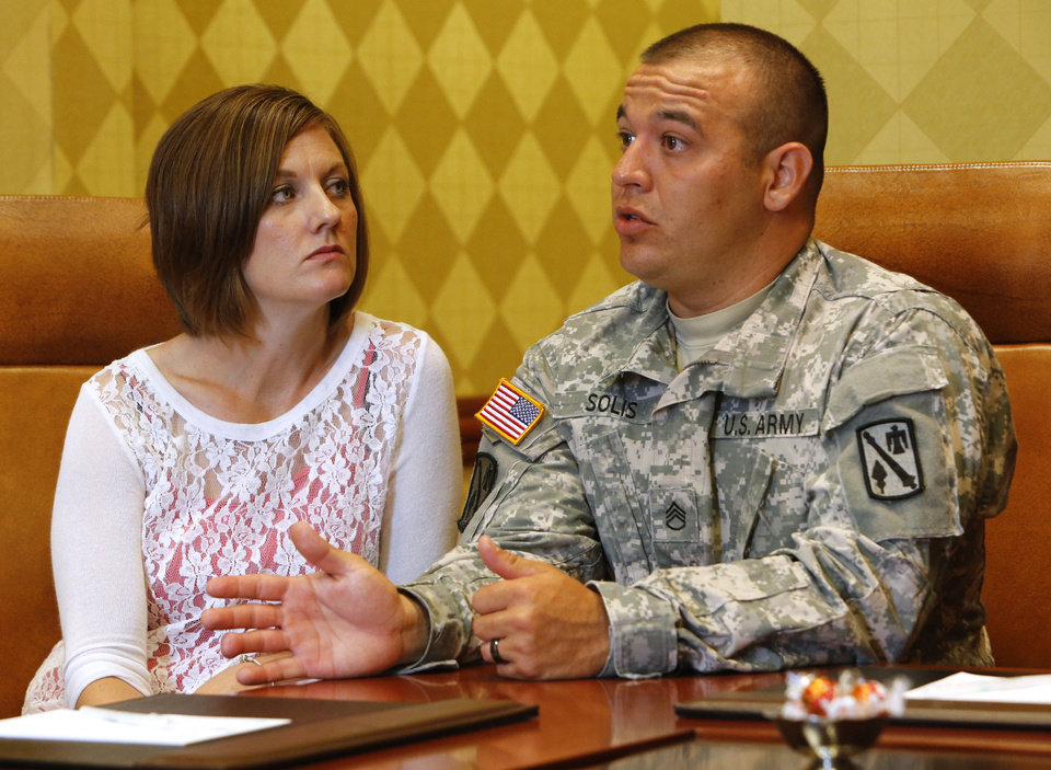 Photo - Margie and Staff Sgt. Chris Solis talk about their participation in the Yellow Ribbon Program for the families of deploying troops June 1 in Norman. Photo by Steve Sisney, The Oklahoman  STEVE SISNEY - THE OKLAHOMAN
