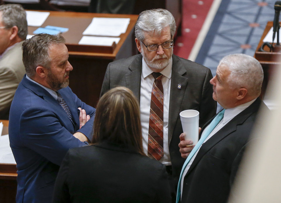 Photo - From left, State Sen. Greg Treat, R-Oklahoma City, Sen. Roger Thompson, R-Okemah, and Sen. Mike Schulz, R-Altus, speak on the floor of the Senate during the fifth day of a walkout by Oklahoma teachers at the state Capitol in Oklahoma City, Friday, April 6, 2018. Photo by Nate Billings, The Oklahoman