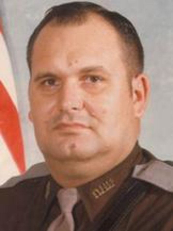 OKLAHOMA HIGHWAY PATROL / MUG: Trooper Edward Elliot  Elliot joined the OHP in 1966.  Troopers Elliott and Tom Flanagan had stopped a truck driver for a traffic violation on the H.E. Bailey Turnpike near Lawton. Trooper Elliott was standing between his cruiser and the truck when a vehicle struck the rear of the unit and propelled it into him. Trooper Elliott was dead on arrival at a Lawton hospital. Trooper Flanagan, sitting in the unit, sustained minor injuries and later recovered.