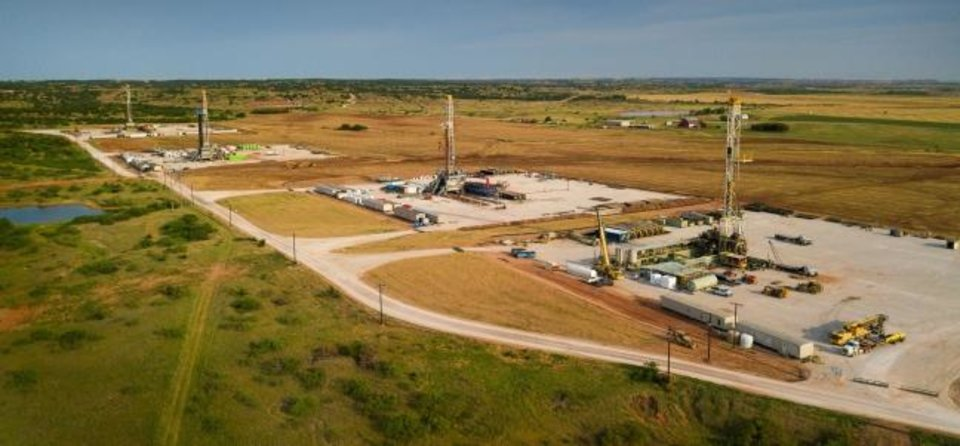 Photo -  Rigs drill wells for Devon Energy in the STACK play of the Anadarko Basin in northwestern Oklahoma. Devon is among the oil and gas producers so far that have announced cuts in their capital expenditure plans for 2020. [PROVIDED]