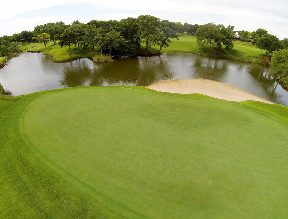 Photo - 13th green. Aerials of Oak Tree National course in Edmond, site of the 2014 U.S. Senior Open, Tuesday, July 1, 2014. Photo by Carl Shortt, Jr., for The Oklahoman