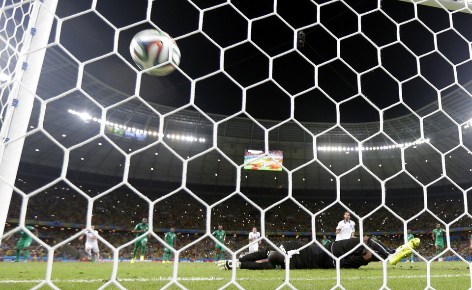 Photo - Greece's Giorgos Samaras, right, scores his side's second goal from the penalty spot during the group C World Cup soccer match between Greece and Ivory Coast at the Arena Castelao in Fortaleza, Brazil, Tuesday, June 24, 2014. (AP Photo/Fernando Llano)
