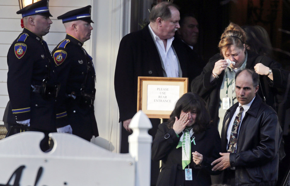Photo - Family and friends react after attending the wake of school shooting victim Victoria Soto, a teacher at Sandy Hook Elementary School, in Stratford, Conn., Tuesday, Dec. 18, 2012.  Soto, 27, was killed when Adam Lanza walked into Sandy Hook Elementary School in Newtown, Conn., Dec. 14, and opened fire, killing 26 people, including 20 children, before killing himself. (AP Photo/Charles Krupa)