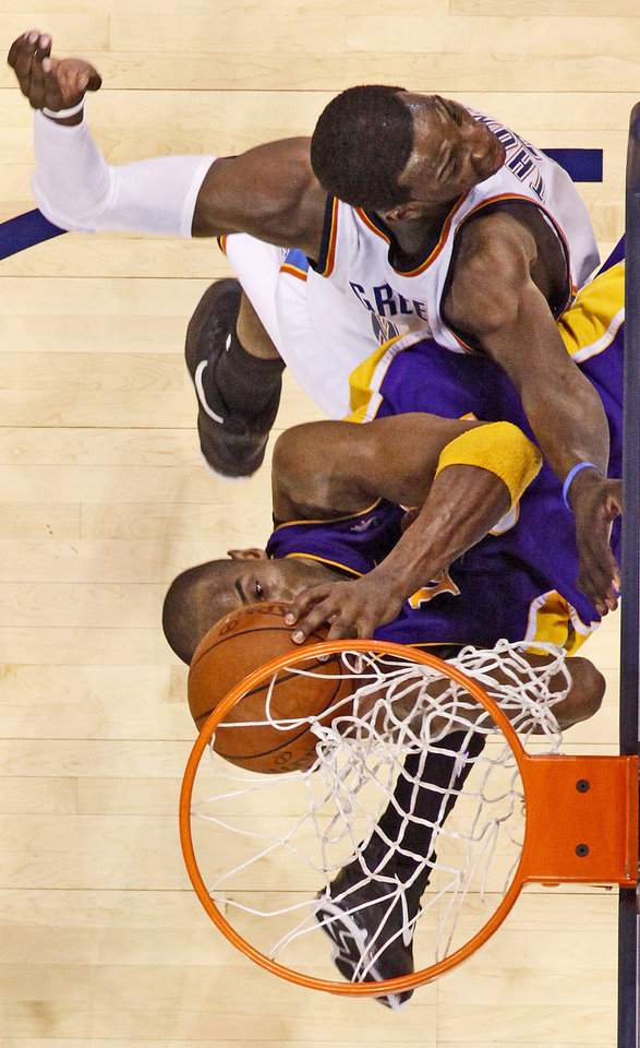 Photo - Oklahoma City's Jeff Green fouls Kobe Bryant of the Lakers during the NBA basketball game between the Los Angeles Lakers and the Oklahoma City Thunder at the Ford Center,Tuesday, Feb. 24, 2009. The Thunder lost 107-93. PHOTO BY BRYAN TERRY, THE OKLAHOMAN