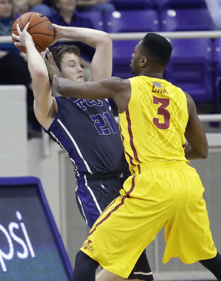 Photo - TCU guard Hudson Price (21) keeps the ball away from Iowa State forward Melvin Ejim (3) during the first half of an NCAA college basketball game Saturday, Feb. 22, 2014, in Fort Worth, Texas. (AP Photo/LM Otero)