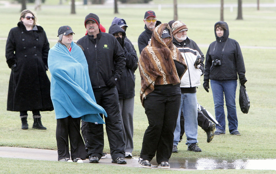 Photo - Spectators watch the 4A girl's sudden-death playoff golf match between Weatherford's Darby Morgan and Poteau's Hannah Ward at the Lake Hefner Golf course in Oklahoma City, OK, Thursday, May 2, 2013. Poteau won the top honor on the first hole.  By Paul Hellstern, The Oklahoman