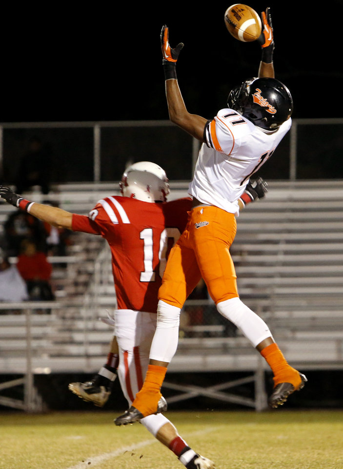 Douglass\' Anthony Williams (11) narrowly misses intercepting a pass intended for McLoud\'s Austin Carroll in high school football on Thursday, Oct. 18, 2012 in McLoud , Okla. Photo by Steve Sisney, The Oklahoman