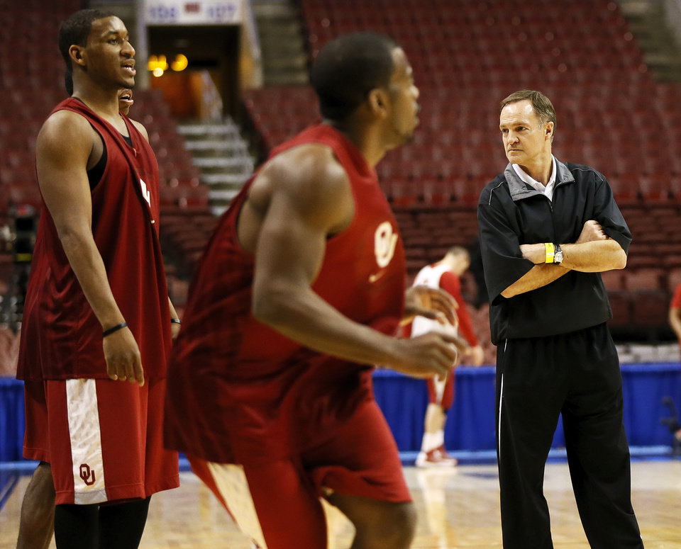 Oklahoma coach Lon Kruger looks to the sideline as Sam Grooms (1), middle, in front of Steven Pledger (2) during the practice and press conference day for the second round of the NCAA men\'s college basketball tournament at the Wells Fargo Center in Philadelphia, Thursday, March 21, 2013. OU will play San Diego State in the second round on Friday. Photo by Nate Billings, The Oklahoman