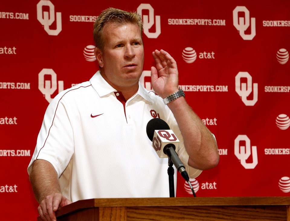 Photo - Defensive Coordinator Mike Stoops  speaks with the media during the Meet the Sooners event at the University of Oklahoma on Saturday, Aug. 4, 2012, in Norman, Okla.  Photo by Steve Sisney, The Oklahoman