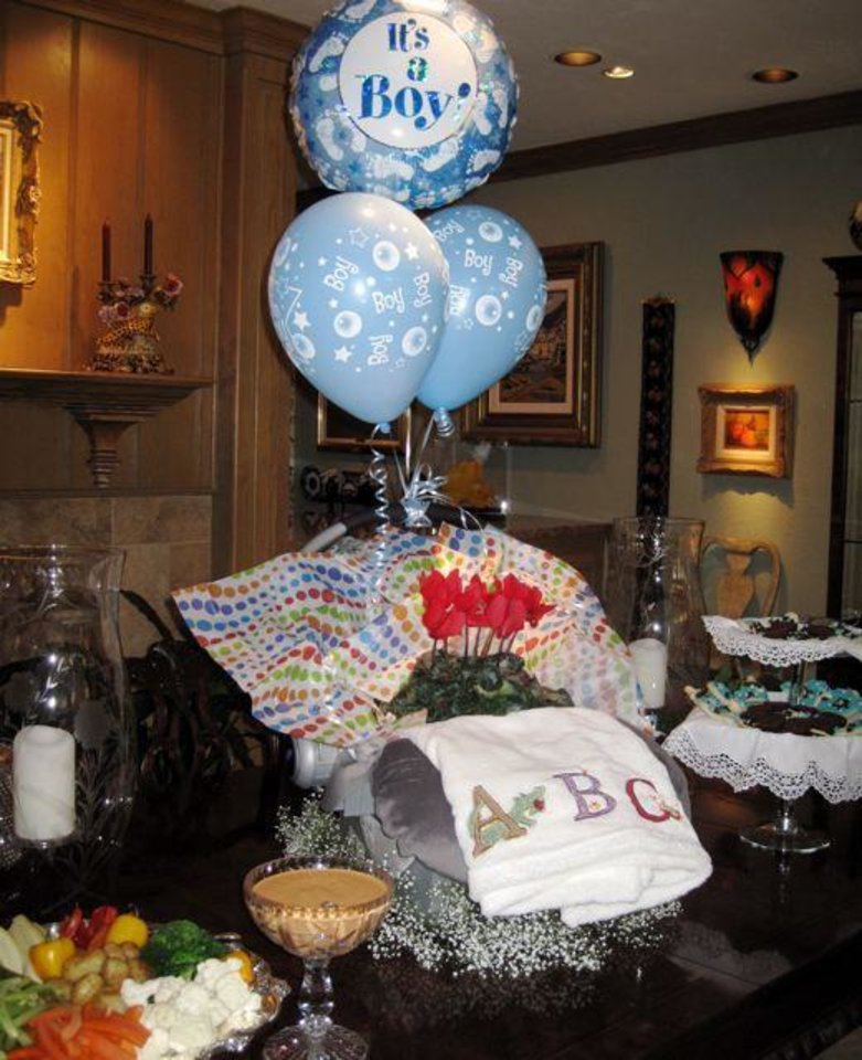COMING SOON....On the buffet tables was a baby\'s car seat decorated with flowers and balloons. It was a gift from the hostesses.(Photo by Helen Ford Wallace.)