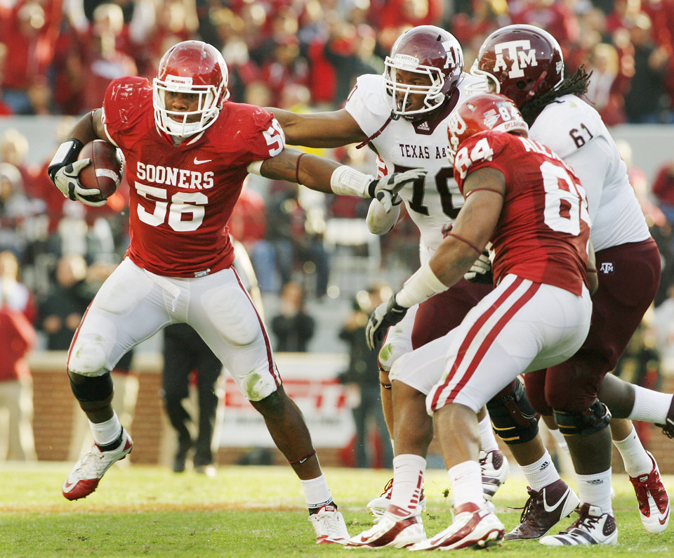 Oklahoma's Ronnell Lewis (56) runs after an interception during the second half of the college football game where the Texas A&M Aggies were defeated by the University of Oklahoma Sooners (OU) 41-25 at Gaylord Family-Oklahoma Memorial Stadium on Saturday, Nov. 5, 2011, in Norman, Okla. Photo by Steve Sisney, The Oklahoman