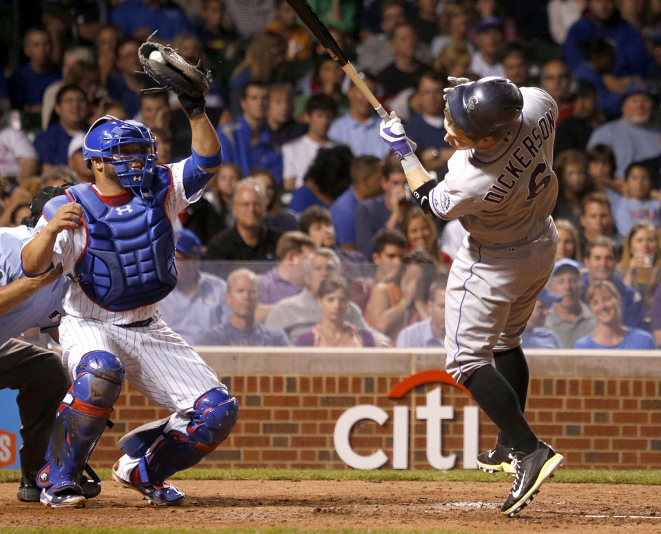Photo - Colorado Rockies' Corey Dickerson reacts to a high pitch from Chicago Cubs' Edwin Jackson, as catcher Welington Castillo grabs the ball, during the fourth inning of a baseball game Tuesday, July 29, 2014, in Chicago. (AP Photo/Charles Rex Arbogast)