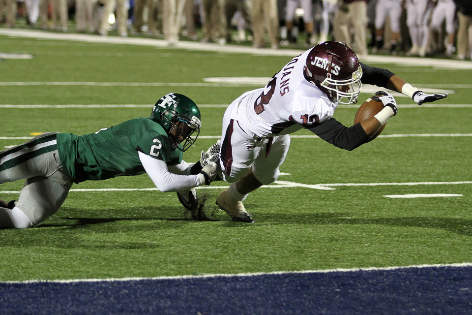 Photo - Edmond Santa Fe's Trevan Smith can't stop Jenks running back Alex Ross from scoring during the Edmond Santa Fe - Jenks game at UCO's Wantland Stadium in Edmond, Friday, November 18, 2011. PHOTO BY HUGH SCOTT, FOR THE OKLAHOMAN